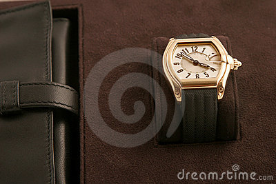 Gold watch with black strap