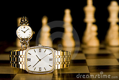 Gold Watches on chess board