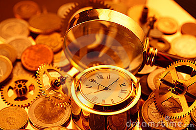 Gold watches, coins, gears and magnifying glass