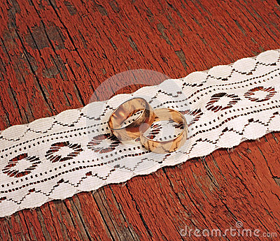 Gold wedding rings on wooden background