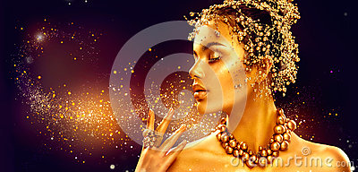 Gold woman skin. Beauty fashion model girl with golden makeup Stock Photo