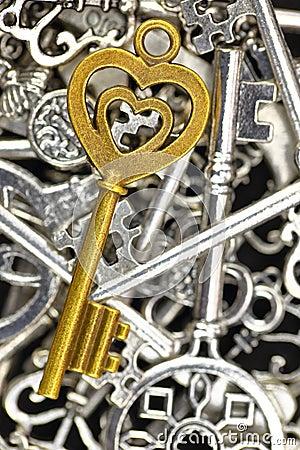 Free Golden Antique Key On Pile Of Metallic Keys Royalty Free Stock Image - 52875476