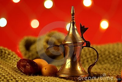 Golden arabic tea pot with dates