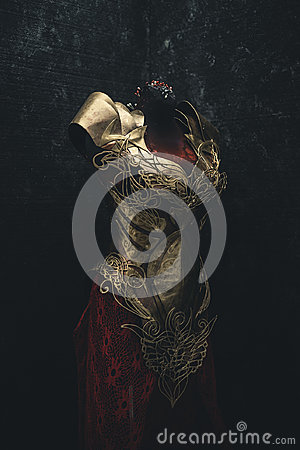 Free Golden Armor For Women. Carries Pieces Of Gold And Fabrics And F Royalty Free Stock Image - 97185536