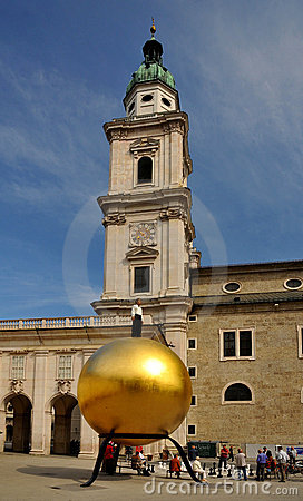 The golden ball with a man on top in Salzburg Editorial Stock Image