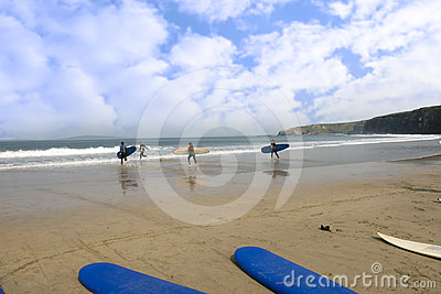 Golden beach with children going to surf Editorial Photography