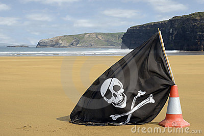 Golden beach with jolly roger flag