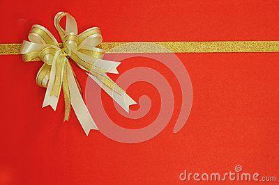 Golden Bow and ribbon on red