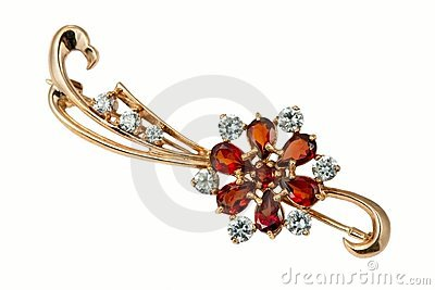 Golden brooch with garnet and  brilliants