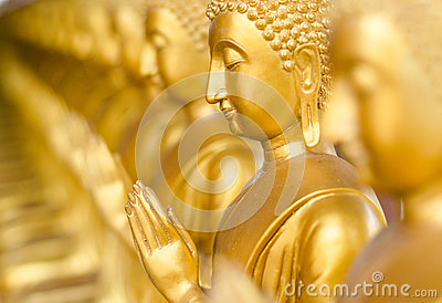 Golden Buddha in ancient temple, Thailand.