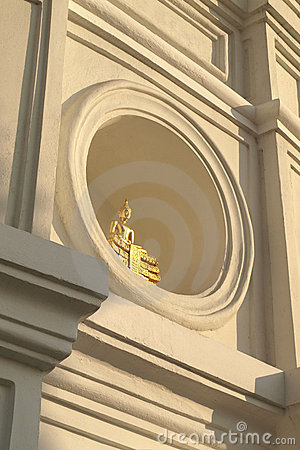 Golden buddha on circle window