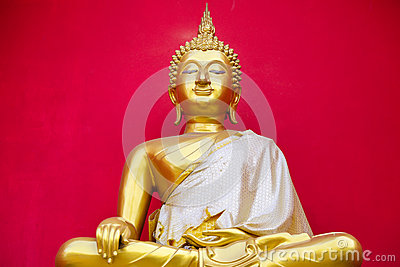 Golden Buddha statue in a Buddhist temple is red background