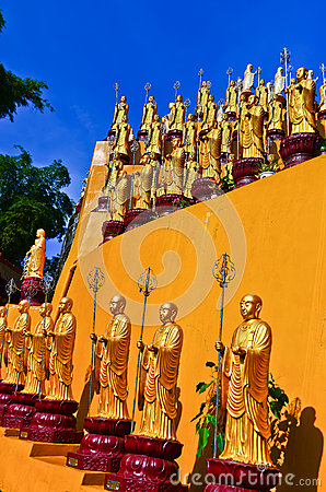 Golden Buddha statues in a temple Stock Photo