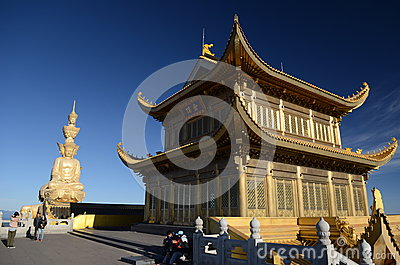 The golden buddha on summit of Emeishan Editorial Image