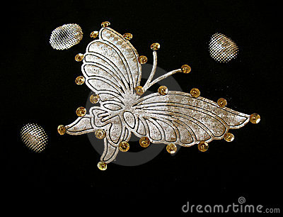 Golden butterfly on fabric