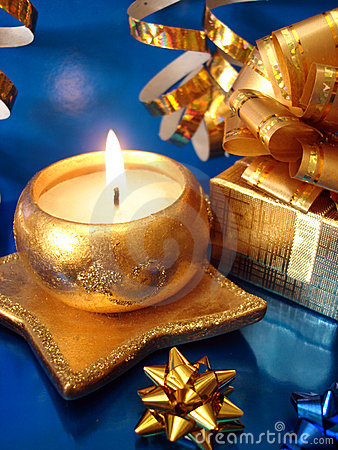 Golden candle and gift box