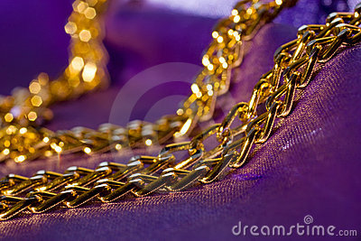Golden chain on shiny silk