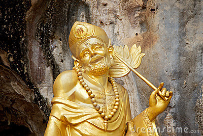 Golden Chinese god statue in Tiger Cave Temple
