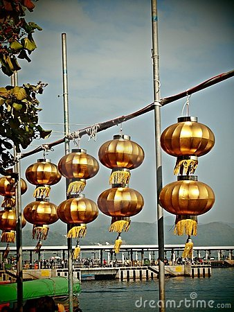 Golden Chinese lanterns under blue sky