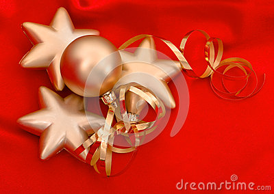 Golden christmas balls over red silk background