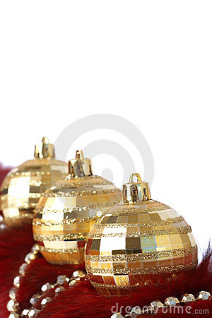 Golden Christmas baubles on fur