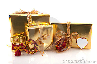 Golden christmas presents with red ornaments