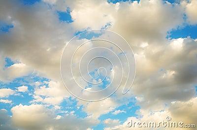 Golden clouds blue sky