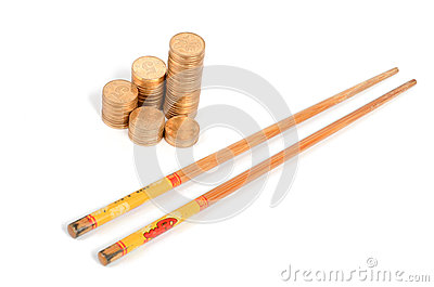 Golden coin and chopstick