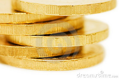 Golden coins isolated over white