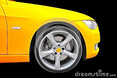 Golden color car - tire close up view