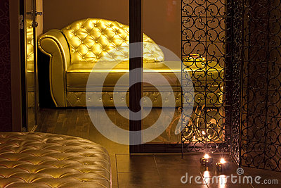 Golden couch in a SPA waiting area
