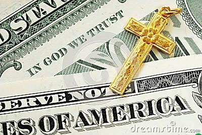 A golden cross on the dollar bills