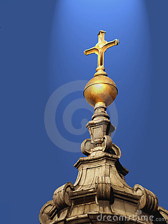Golden cross on holy light from the sky.