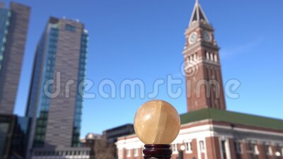Golden crystal ball and Seattle downtown for hope and fortune. A panning footage of golden crystal ball and Seattle downtown for hope and fortune stock footage
