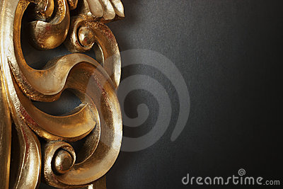 Golden decoration on dark wall