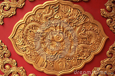 Golden dragon sculpture decorated on red wall