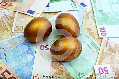 Golden Eggs sitting on money