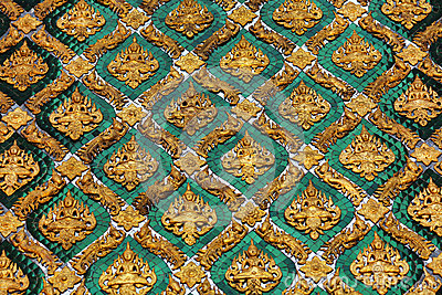 Golden and emerald wall decoration on temple in Th