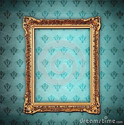 Golden frame over grunge wallpaper