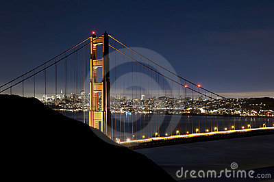 Golden Gate Bridge at night with San Francisco sky
