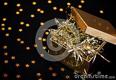 Golden gift box on black background