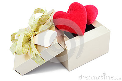 Golden gift box and red heart.