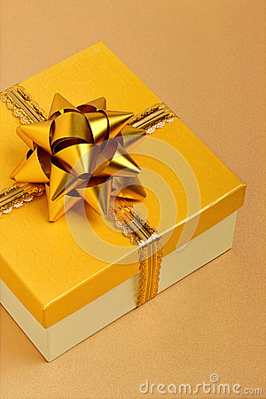 Golden gift box on the tablecloth