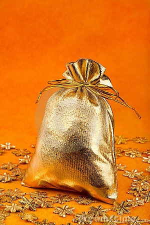 Golden gift sack and golden snowflakes