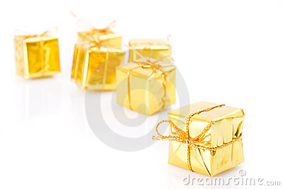 Golden gifts isolated on white