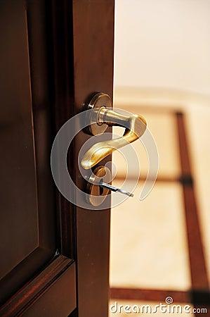 Golden door handle from a luxury hotel room