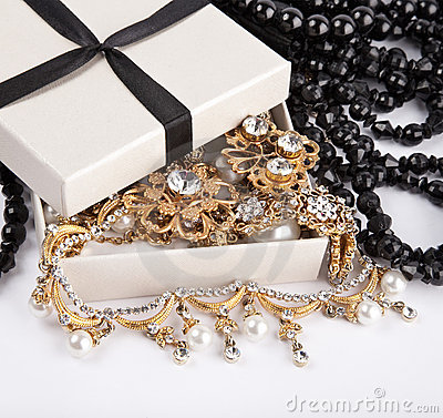 Golden jewelry in box