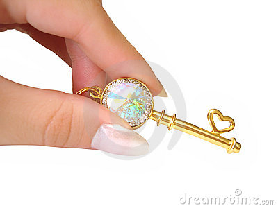 Golden key on hand isolated