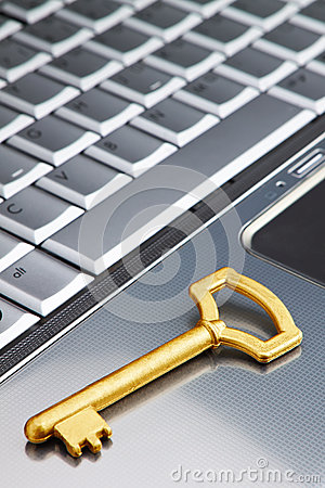 Golden key on a laptop security symbol on the Internet.