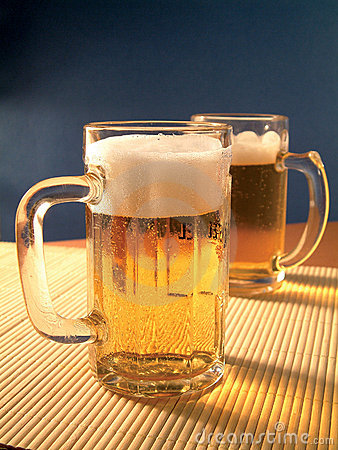Golden lager beer drink in table